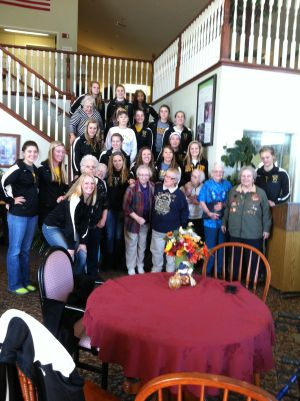 St. Peter's Gustavus girls volleyball team and Ecumen Sand Prairie Assisted Living residents pen pals