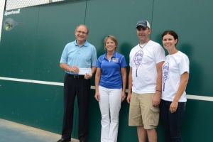 Modern Woodmen Insurance of Le Sueur donates to tennis hitting wall in memory of Katelyn Hank