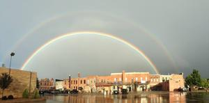 Double rainbow engulfs downtown St. Peter