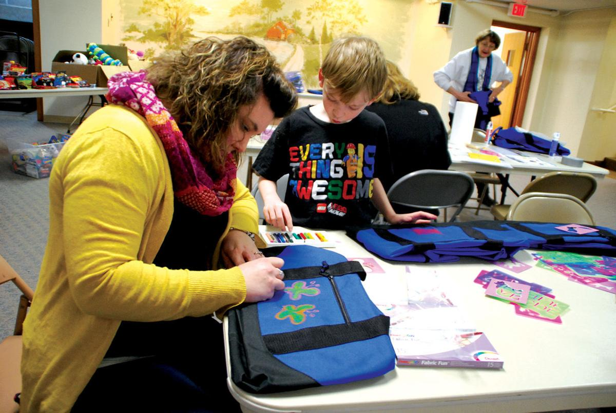 Trinity church prepares personal bags for foster kids