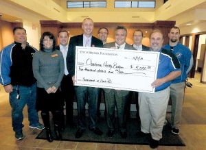 Otto Bremer Foundation donates to the Owatonna Husky Bulllpen Club