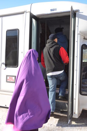 ESL adult learners board the bus.