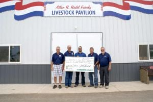 Owatonna Public Utilities presents rebate to the Steele County F