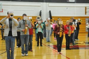 Marchers practice for indoor concert
