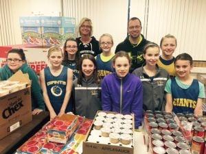 Le Sueur-Henderson girls basketball team helps stuff backpacks for classmates