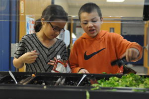 K'Shawn Coleman and Faduma Mungani choose vegetables at lunchtime