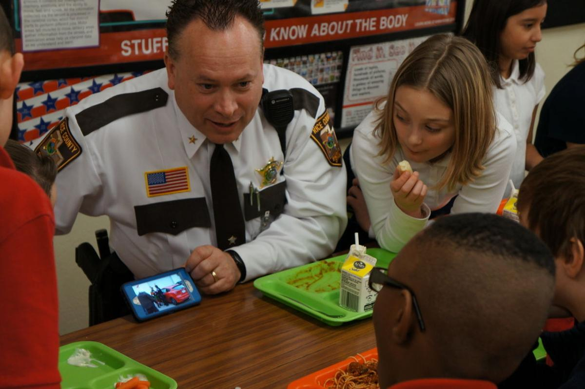 Local law enforcement visit Divine Mercy Catholic School for new lunch program