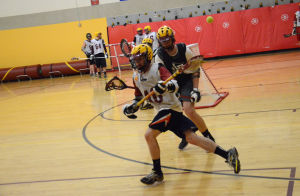<p>An attacker gets the ball knocked out of his stick Monday during a one-on-one drill. (Jordan Osterman/Northfield News)</p>