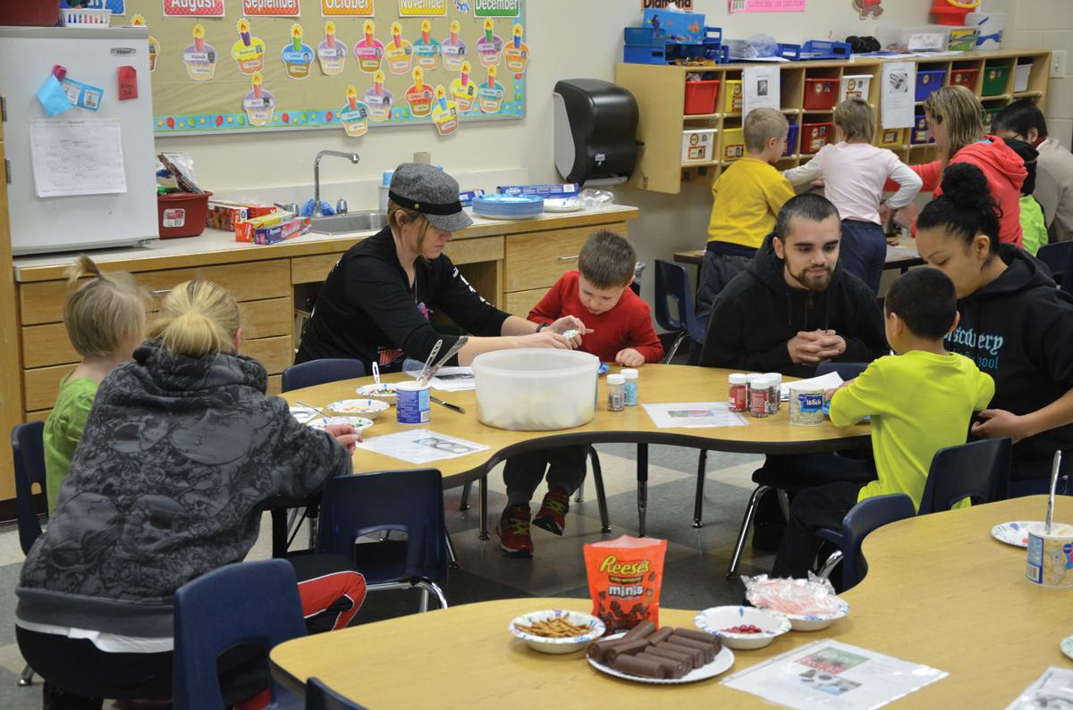 Families bond over Christmas cookies at Medford ECFE make-and-take