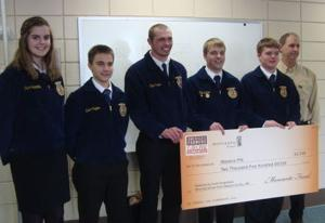 Farmer directs $2,500 donation to Waseca FFA