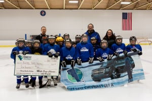Matt Saxe Chevrolet in Belle Plaine makes donation to the Bulldog Youth Hockey Association