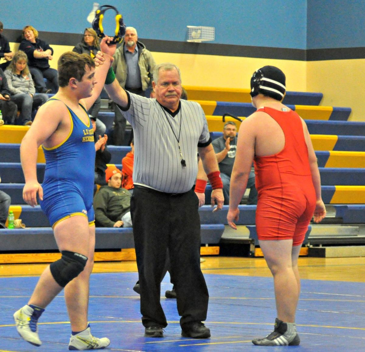 Rogich picks up two big victories as Giants split triangular