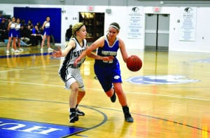 <p>Owatonna senior Angie Farrier, seen here driving against Rochester Century, has overcome a bevy of obstacles these past two years during her return back to the Huskies' starting lineup this season. (Kaleb Roedel/People's Press)</p>