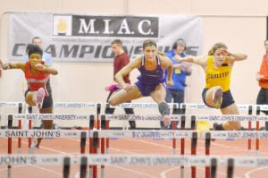 <p>Carleton College's Amelia Campbell (far right) set a school record in the 60-meter hurdles with a time of 8.88 seconds at the 2014 Indoor Track and Field MIAC Championships this past weekend in Collegeville. She also set a school, MIAC and NCAA Div. III record with 3,914 points in the pentathlon. (Matt Higgins/MIAC Conference)</p>