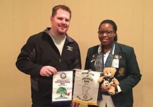 Janesville Rotary exchanges banners with South African club member