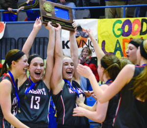 <p>Siri Sviggum (from left), Audra Clark and Meg Clark hold up the Knights' Section 1AA West championship plaque as their teammates run to meet them on Saturday at the Mayo Civic Center Auditorium. Kenyon-Wanamingo beat Hayfield 60-58 to claim the sub-section crown and come within a win of the state tournament. (Josh Berhow/Daily News)</p>