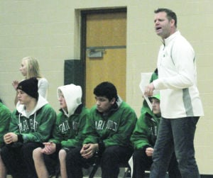 <p>Faribault wrestling coach Jesse Armbruster (right) coaches from the sideline during the Falcons' dual against Northfield on Dec. 20 at Faribault High School. (Miles Trump/Daily News)</p>