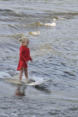 Sophia Belcher rides a standing board