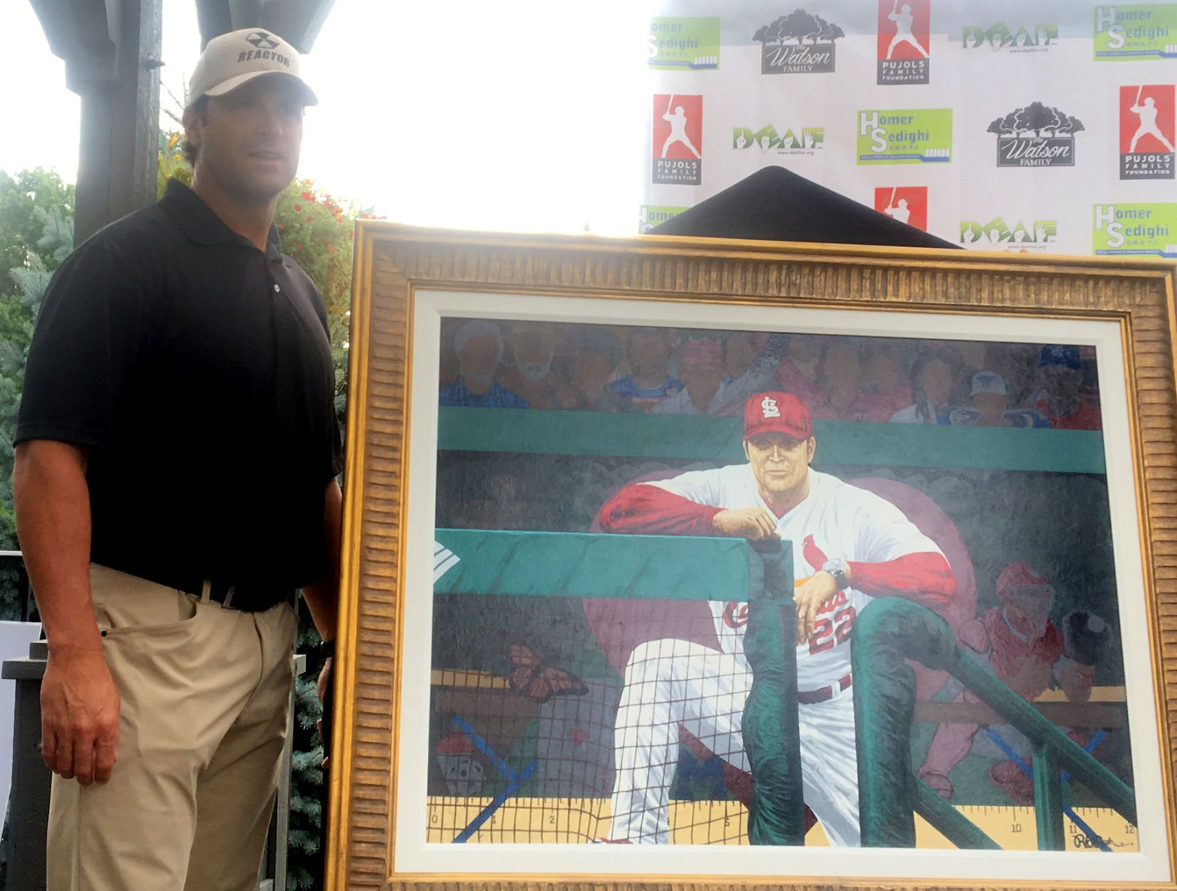 Matheny honored with painting at Pujols Golf Tournament