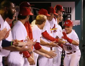 Wong's grand slam powers Cards to win