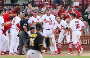 Wong's homer wraps up sweep of Pirates