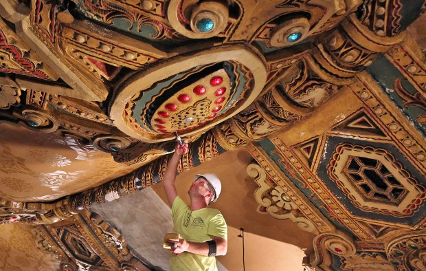 Brad Stewart with EverGreene Architectural Arts injects a thin acrylic polymer into the plaster of the ceiling of the Fox Theatre