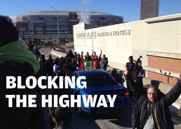 Protesters block a downtown highway as cleanup continues