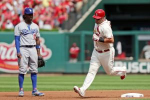 Cards beat Dodgers again, but Holliday hurt