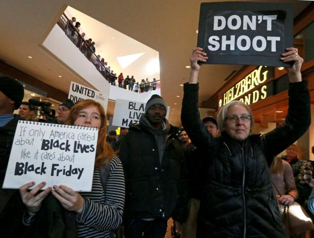 Protesters march through Galleria as Black Friday shopping picks up steam across metro area