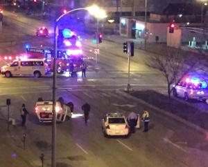 Police SUV flips after it's hit by red light runner in downtown St. Louis, authorities say