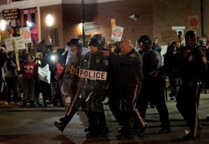 Police arrest 5 in protest outside Ferguson police headquarters