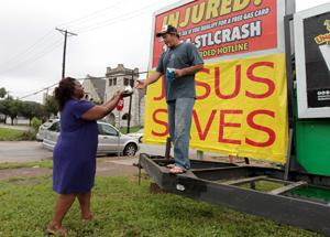 Billboard sitter ends vigil as St. Louis notches another murder