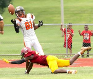 Thomas' catch lifts Statesmen past stunned Spartans
