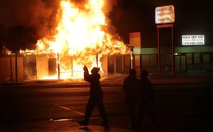 Firefighters tell Missouri lawmakers that they couldn't fight Ferguson fires unprotected