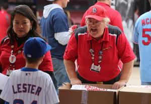She loves her job at Busch Stadium, but she's cheering for the Cubs