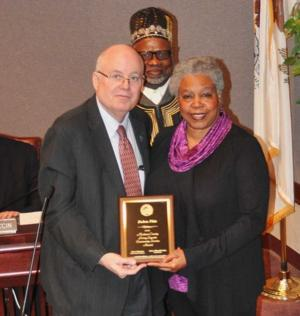 Area educator and volunteer honored by county board
