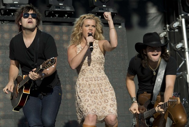 (From left) Neil, Kimberly and Reid Perry, perform at the Boots and Hearts Canadian Country Music Festival, Saturday, August 3, 2013, at Canadian Tire Motorsport Park in Bowmanville, Ontario.  The Canadian Press Images PHOTO/Boots and Hearts Music Festival