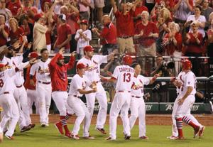 Cardinals beat D'backs on wild throw in ninth