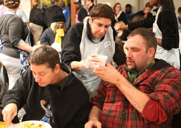 Thanksgiving event in downtown St. Louis attracts more volunteers than it can handle