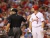 Matt Holliday and umpire look into stands at Busch Stadium