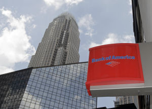 Bank of America posts loss, hurt by $6B legal expenses