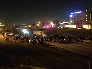 Hundreds of marchers force brief shut-down of Interstate 44