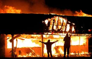 Ferguson update: Fires, looting and shots overnight