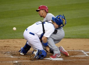 Jon Jay plows through A.J. Ellis