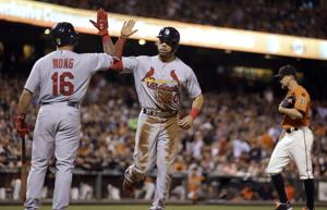 Giants walk, walk, walk off with win vs. wobbly Cards