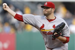 Molina gets a break as Cueto tries to pitch Reds to series win
