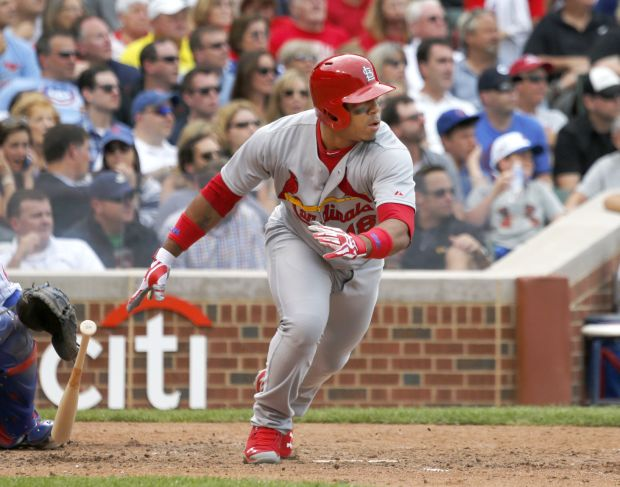 Cards blow two leads, lose wild one at Wrigley