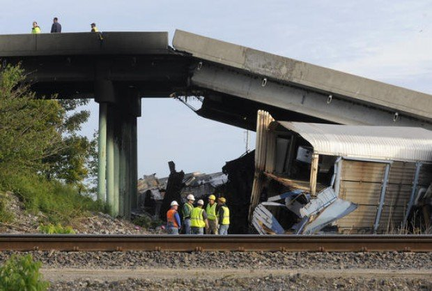 Seven hurt when trains collide, spurring collapse of southeast Missouri overpass
