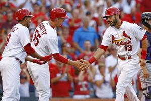 Cardinals rally in ninth for 9-8 win