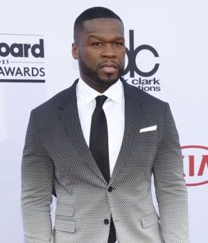 Rapper 50 Cent presents check in Ferguson